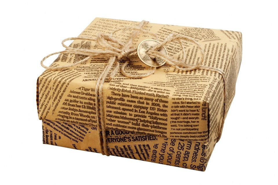 Don't throw away that pile of newspaper because you can use them creatively as wrapping paper.
